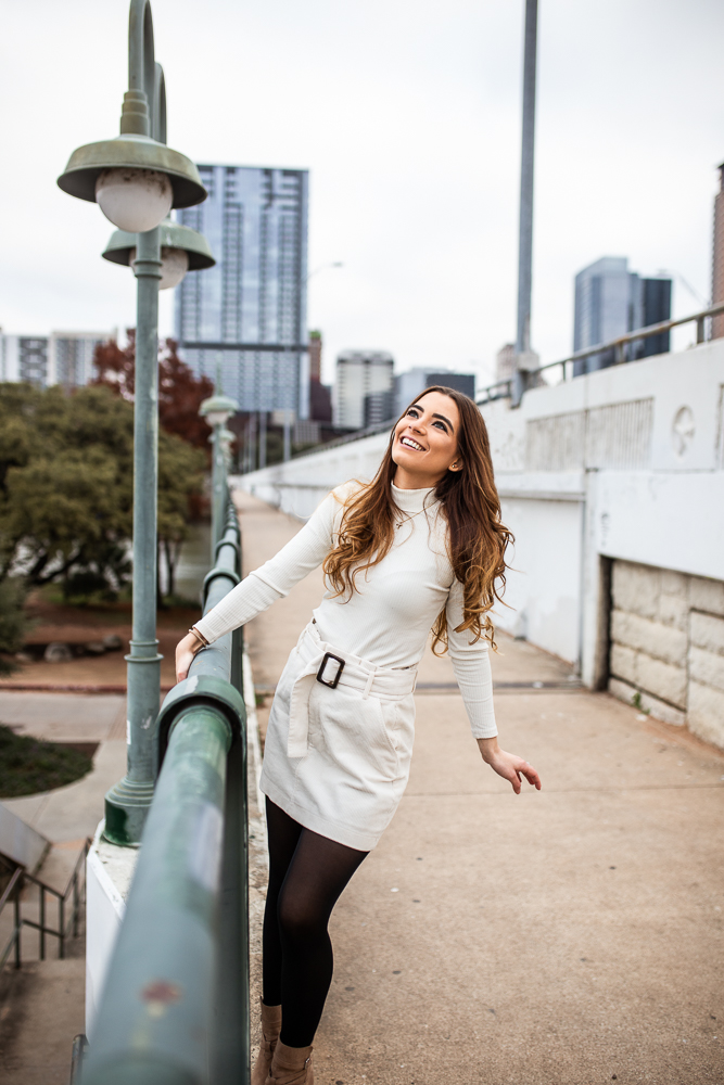 Lifestyle senior portrait session on S. t1st bridge. Girl wearing white sweater and white skirt. Photo by Erin Reas senior photographer.
