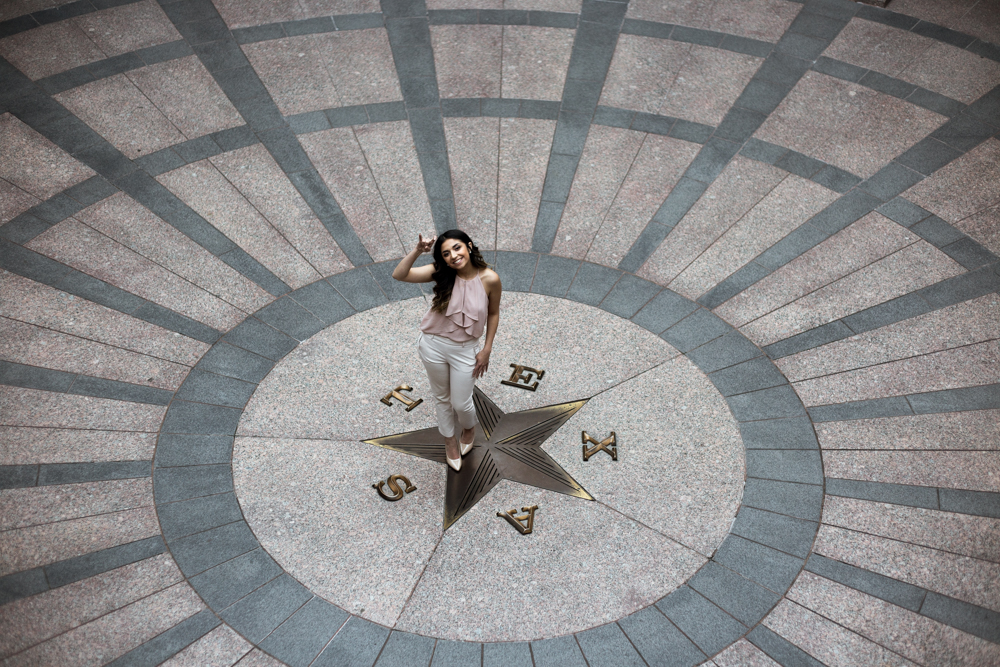 college graduate senior portrait in texas state capitol building. inside the rotunda of the capitol building. photo by erin reas austin photographer