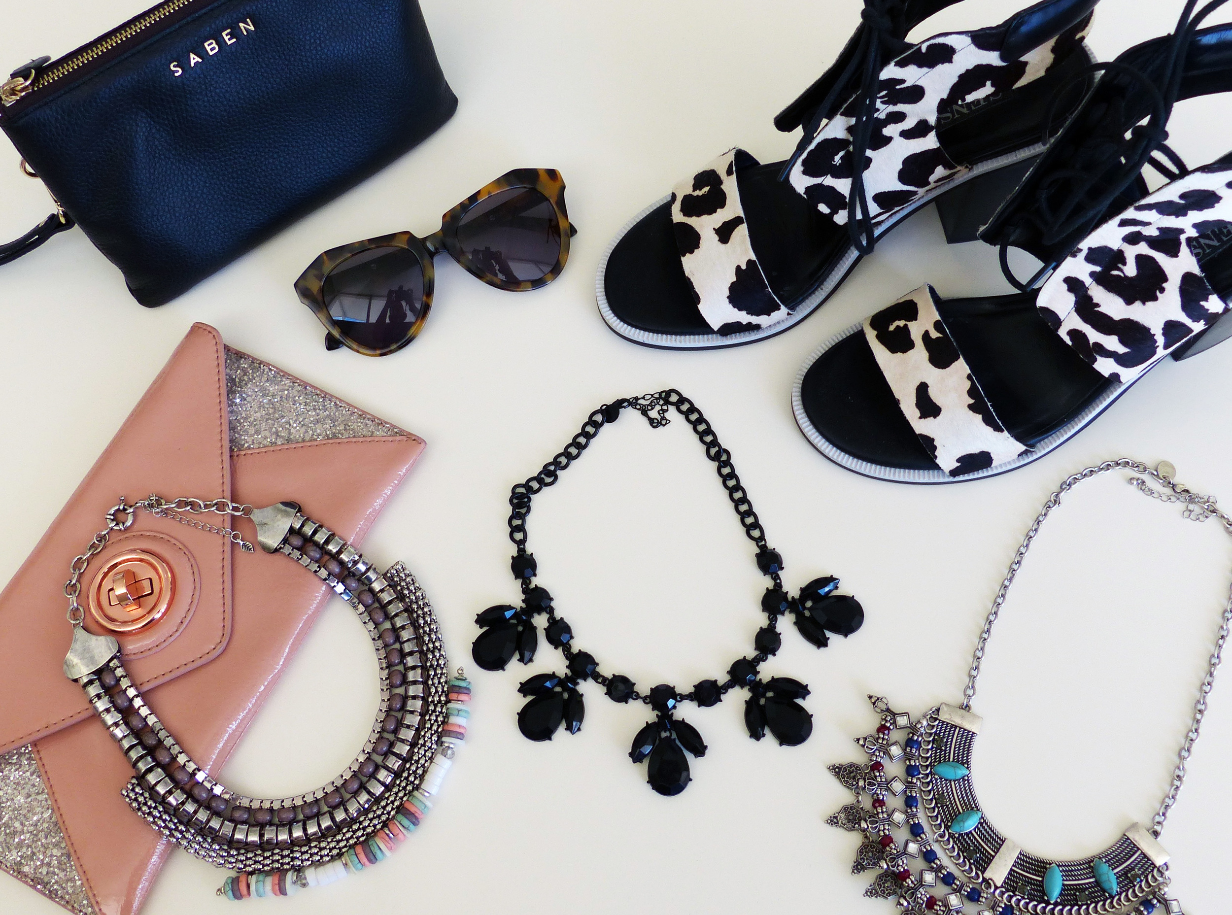Saben 'Tilly' pouch, Karen Walker sunglasses, Senso heels, Mimco clutch, necklaces by Jeanwest, Lovisa and Equip.