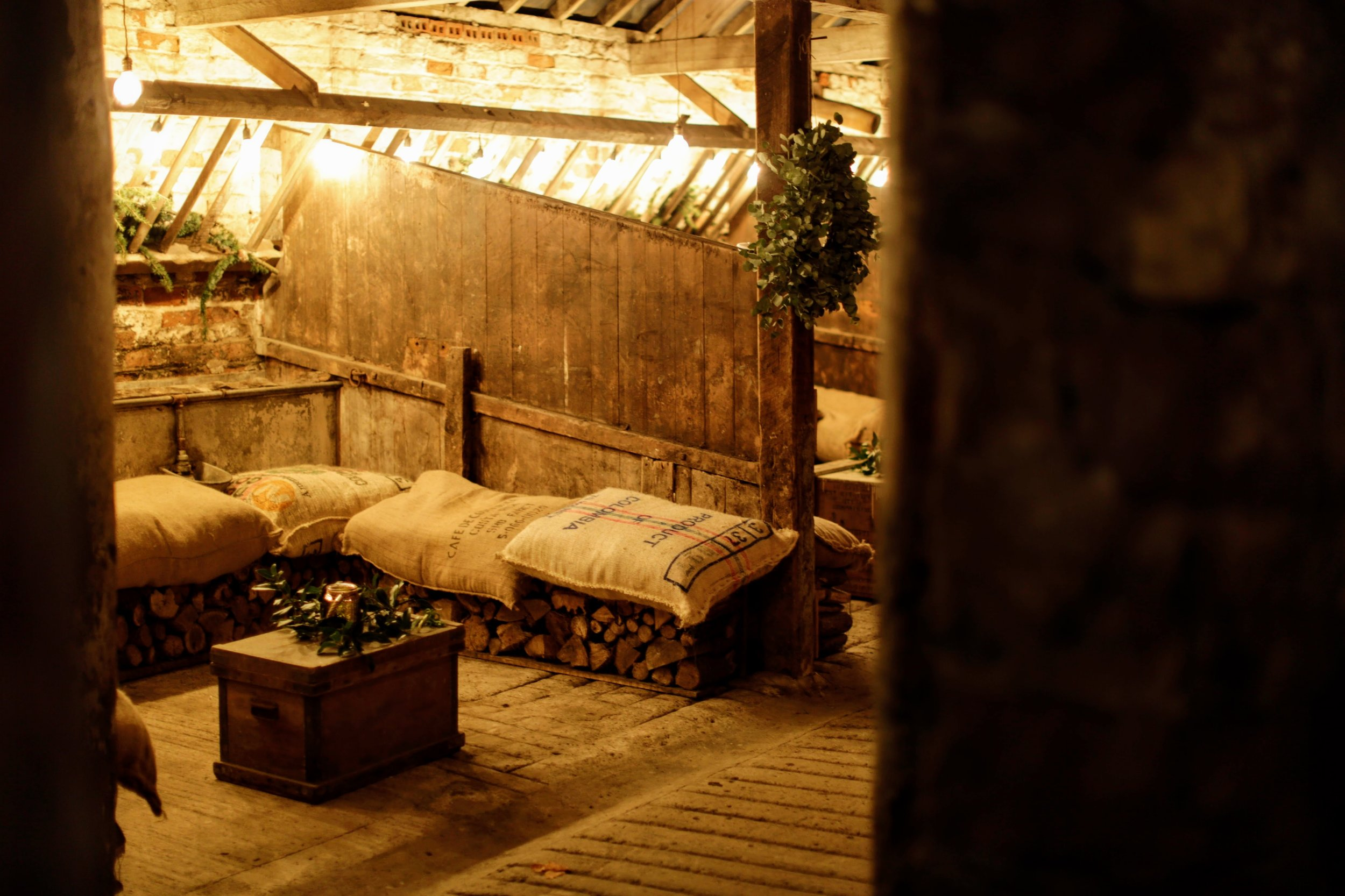 Cosy up in the Cow Stalls at The Normans wedding venue Photo by www.dylannoltephotography.com