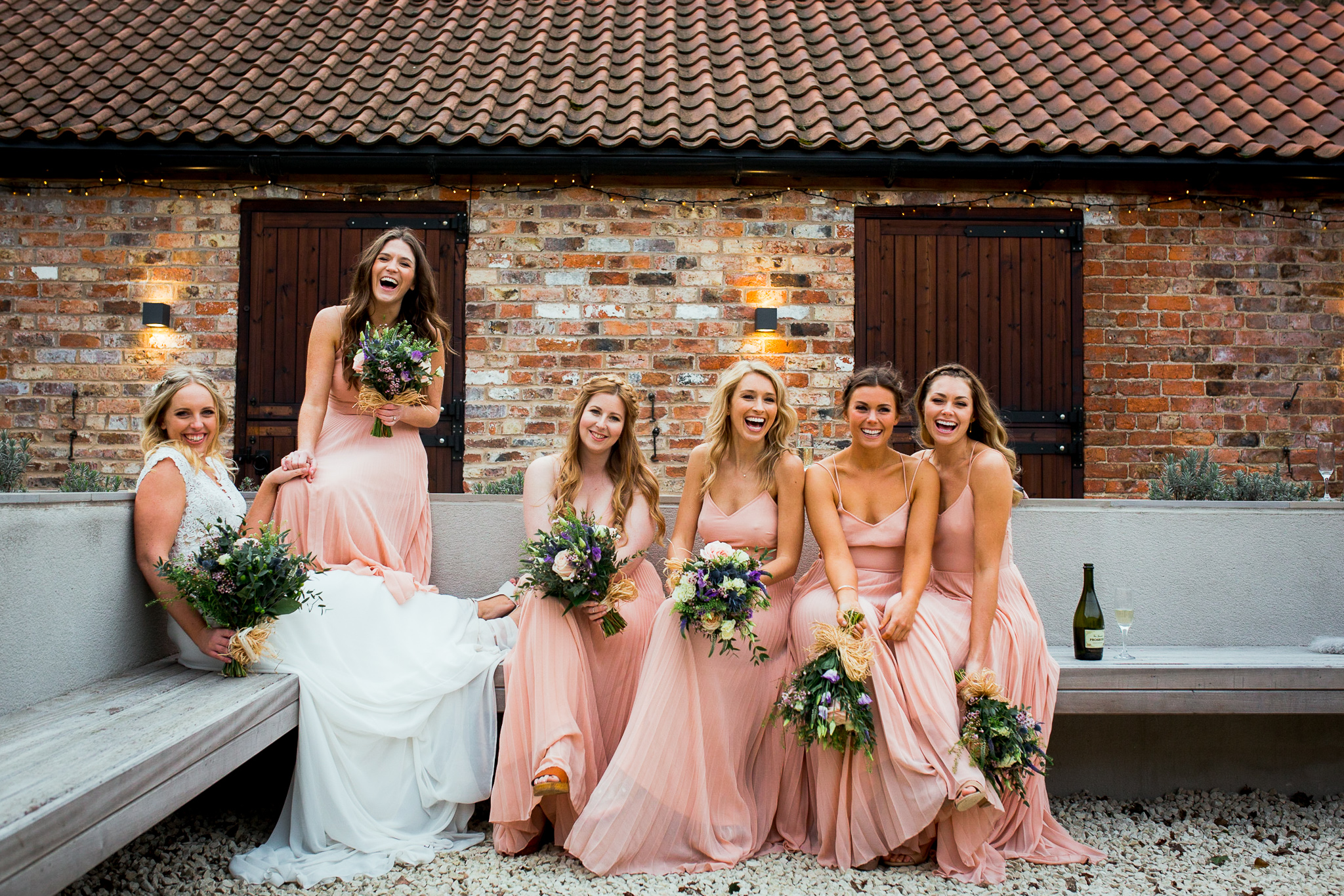 Bridesmaids in The Normans Courtyard. Photo by www.timdunk.com