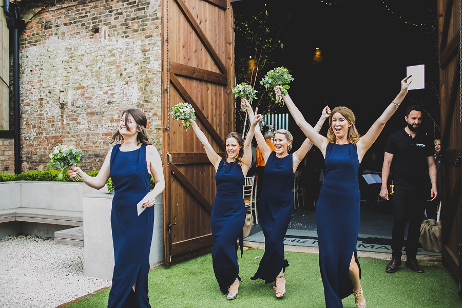 Bridesmaids celebrate at The Normans Photo by www.nicolaphotography.co.uk