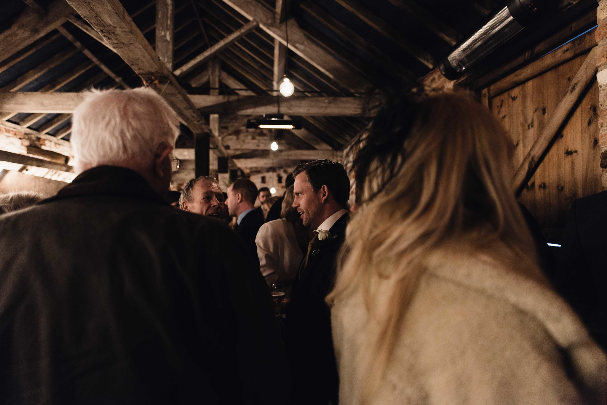 Mingling in The Normans Cow Stalls. Photo by www.alexandraholtphotography.com