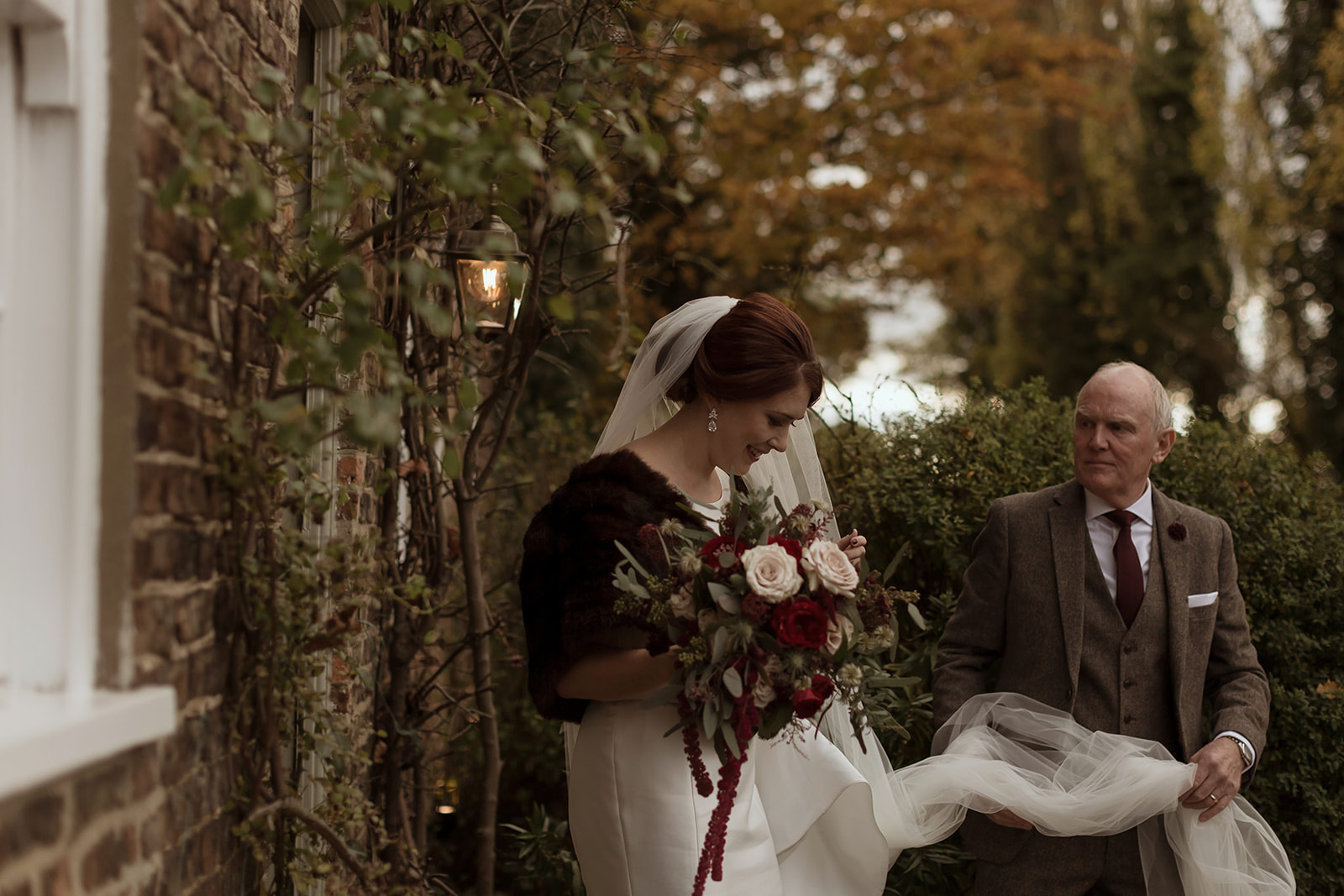 Bride Laura leaves The Normans Cottage and heads to the Ceremony Barn - photo by Luke Bell.jpg