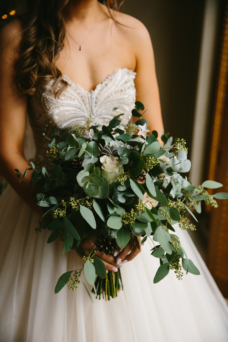 Jess's beautiful dress and bouquet at The Normans wedding venue