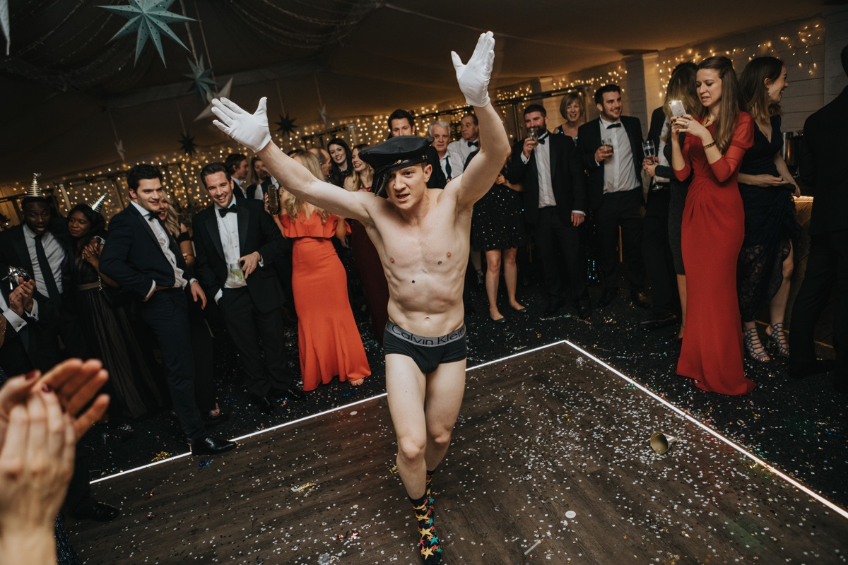 No New Year is complete without an impromptu appearance from a stripper/partially dressed guest. Photo by Bloom Weddings