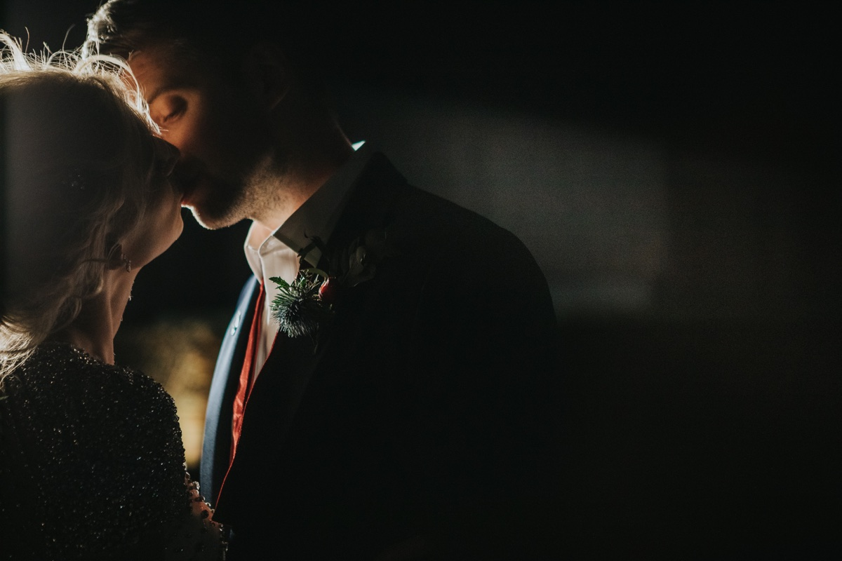 Sealed with a kiss at The Normans. Photo by Bloom Weddings