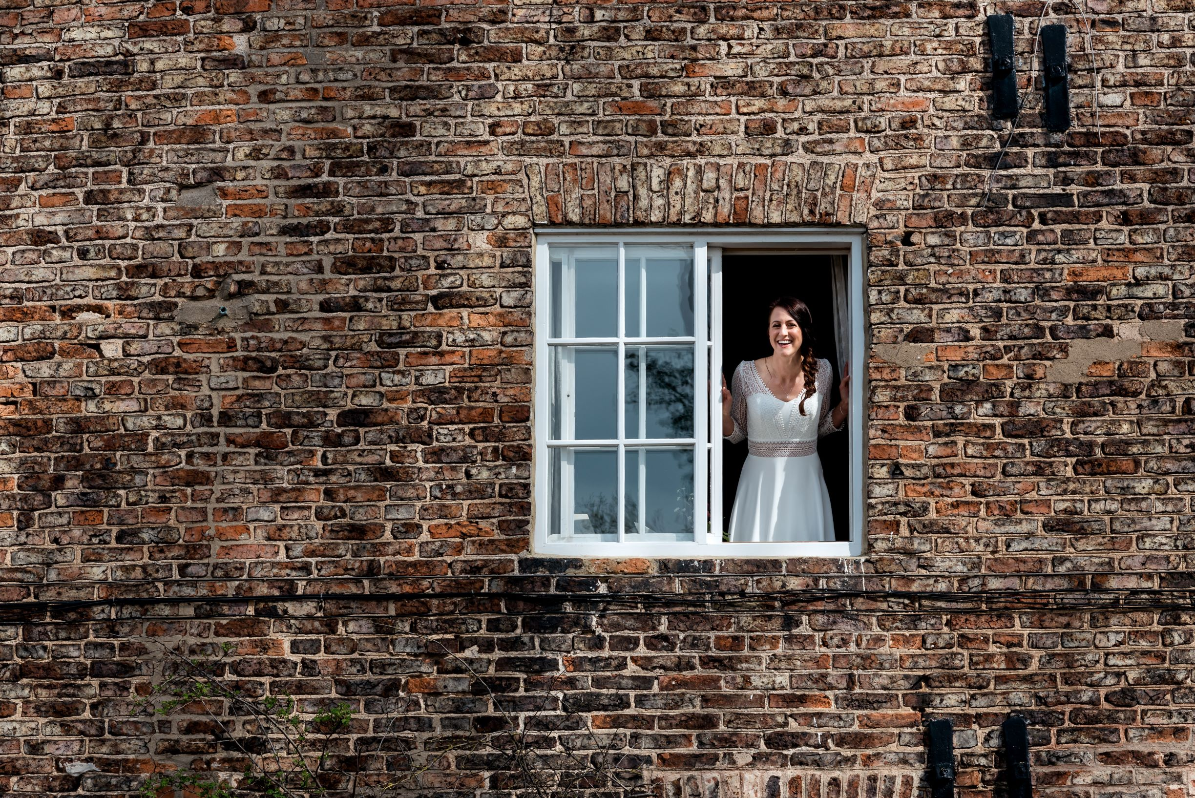 Laura greets the adoring masses from the window of The Normans Cottage.jpg