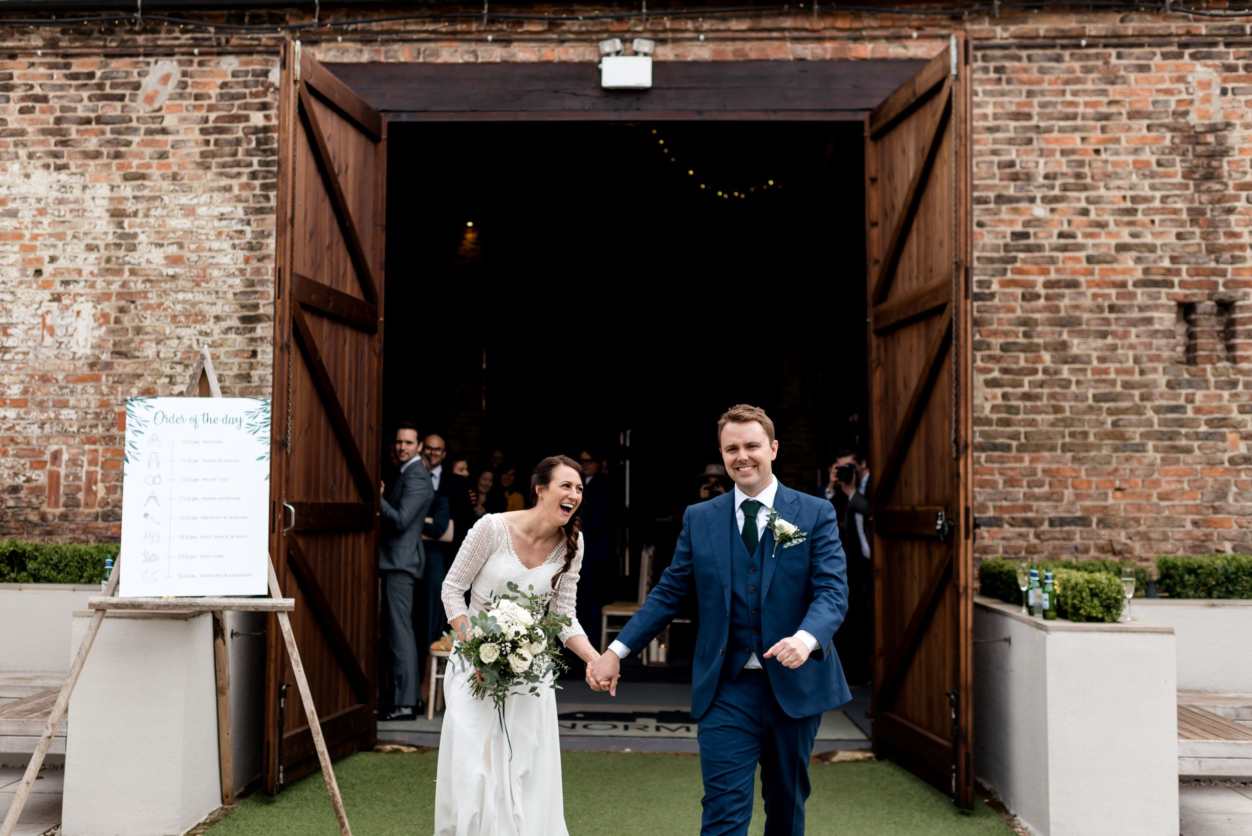 Lols all round as James and Laura emerge from The Normans Ceremony Barn as man and wife.jpg