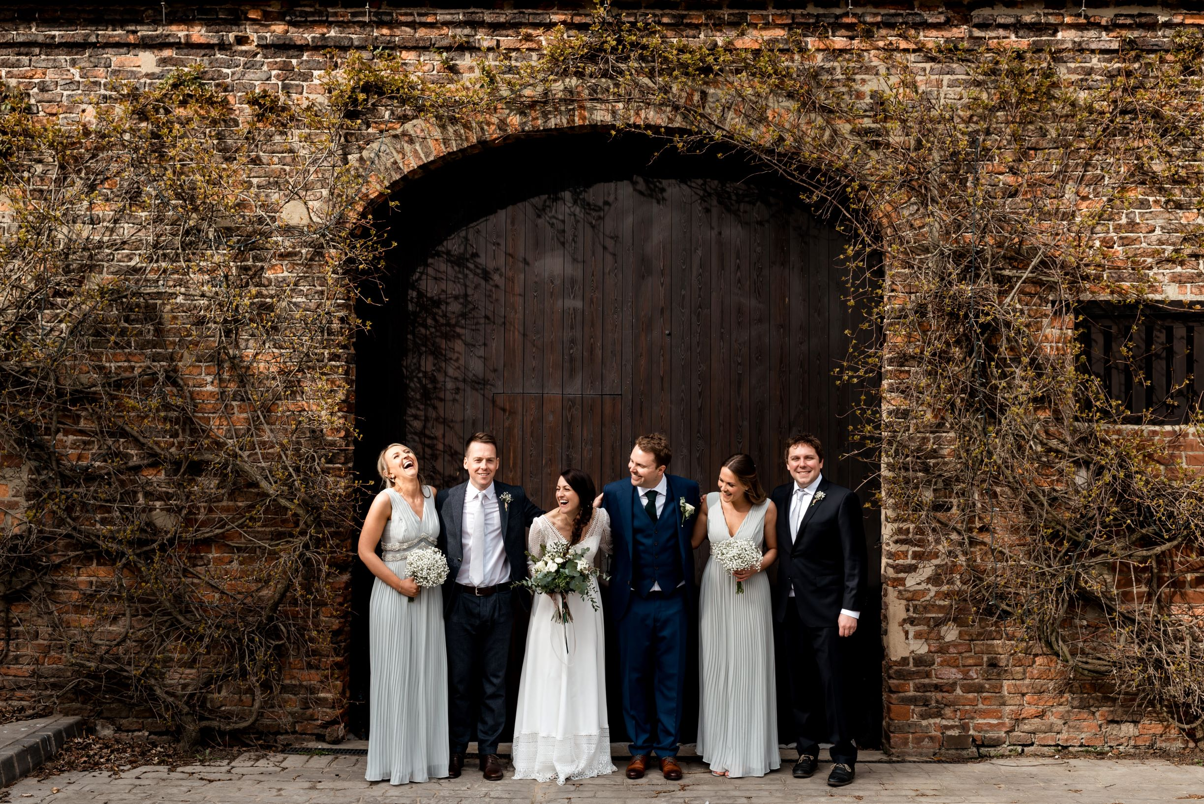 Laura and James with their bridesmaids and groomsmen.jpg