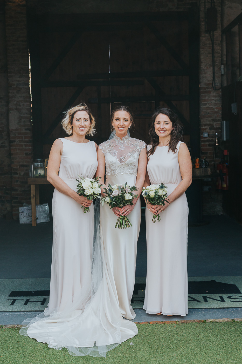Jaimie with her beautiful bridesmaids.jpg