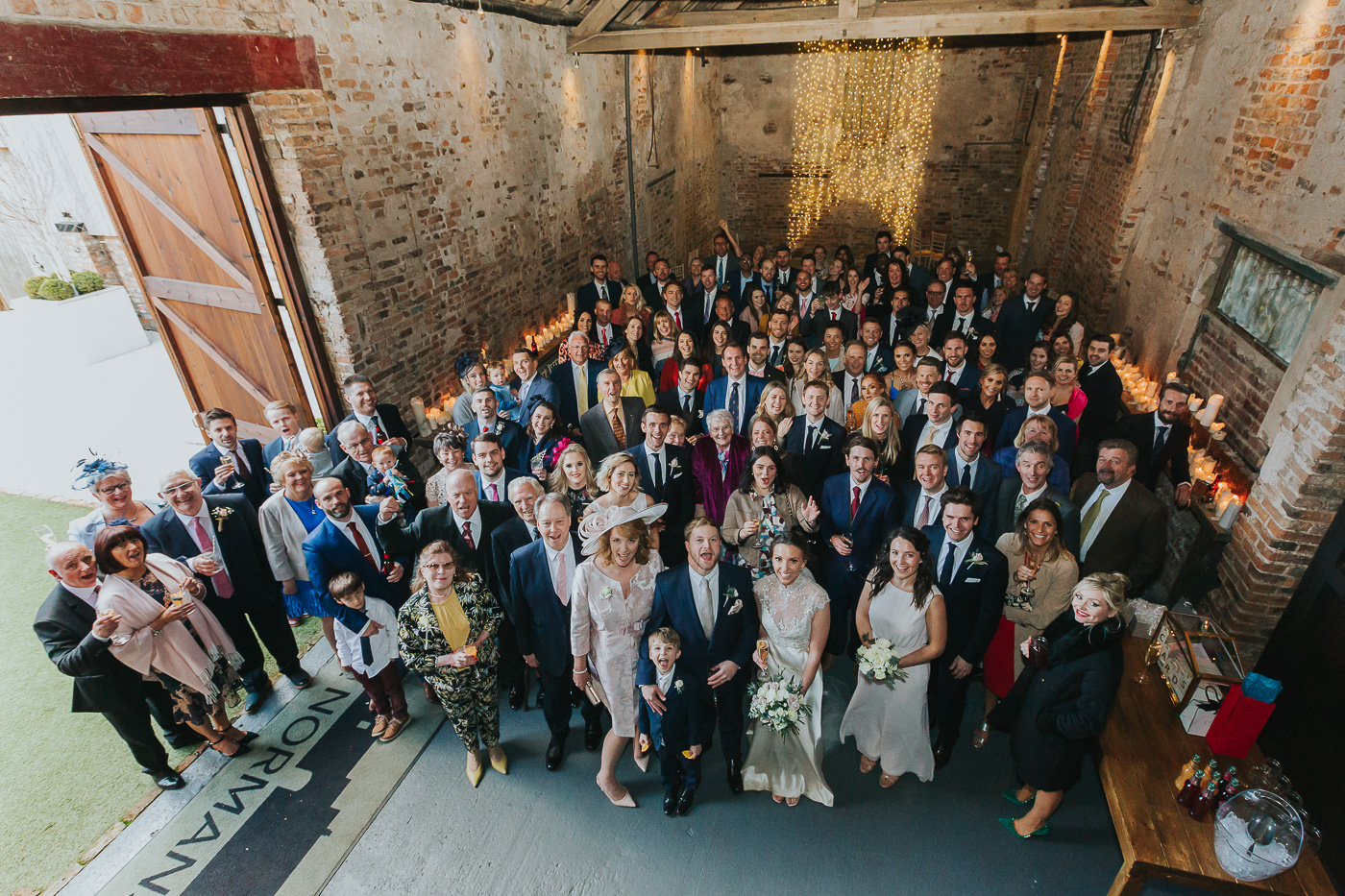 In the absence of a ceremony here at The Normans, the barn made for a great place for a group photo..jpg