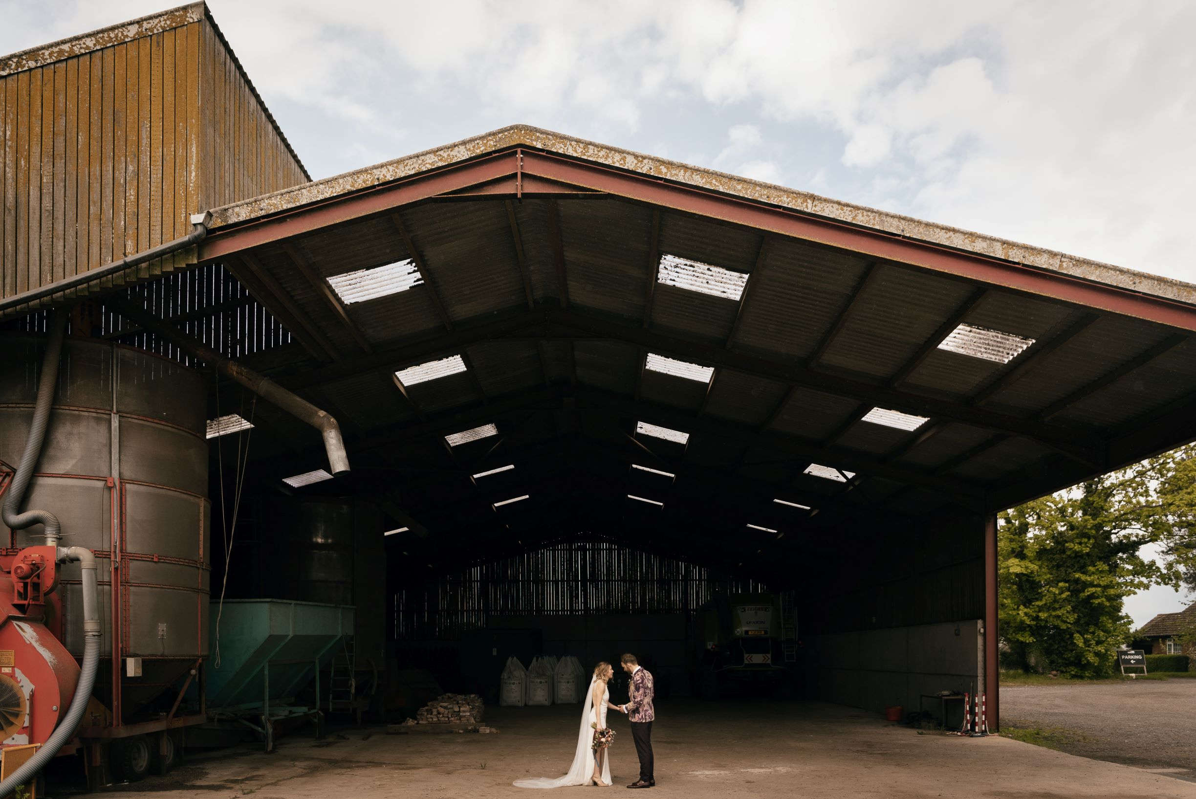Emily & James in a massive Grain Shed. Photo by www.julesbarron.com