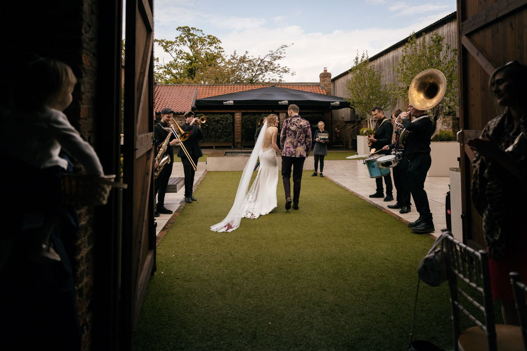 New York Brass Band serenade bride and groom in The Normans Courtyard. Photo by www.julesbarron.com