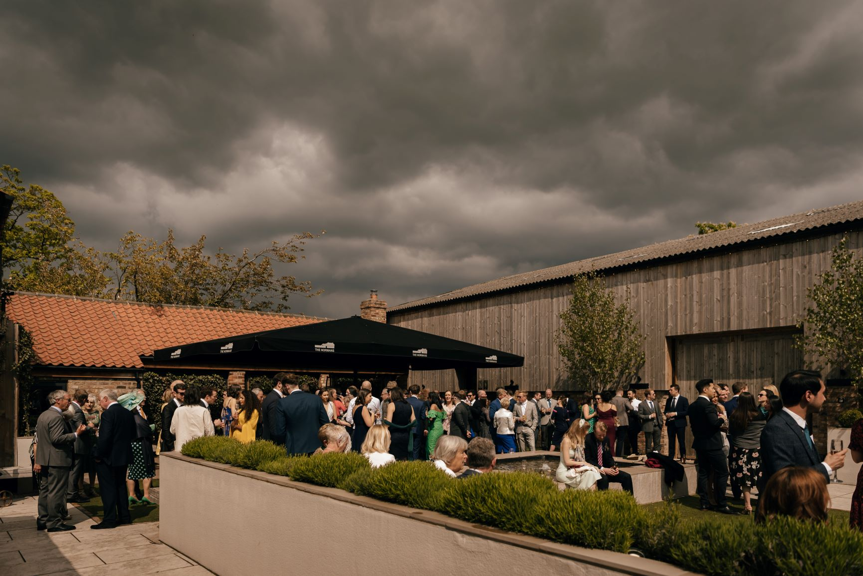 Brooding skies didn't deter guests from merrymaking in The Normans Courtyard. Photo by www.julesbarron.com