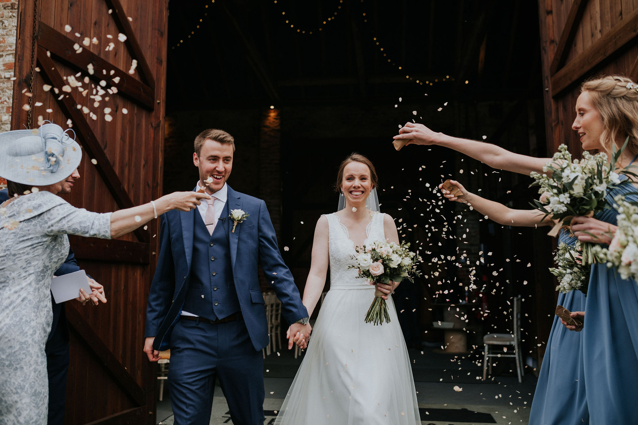 Confetti swirls in the breeze outside The Normans Ceremony Barn.jpg
