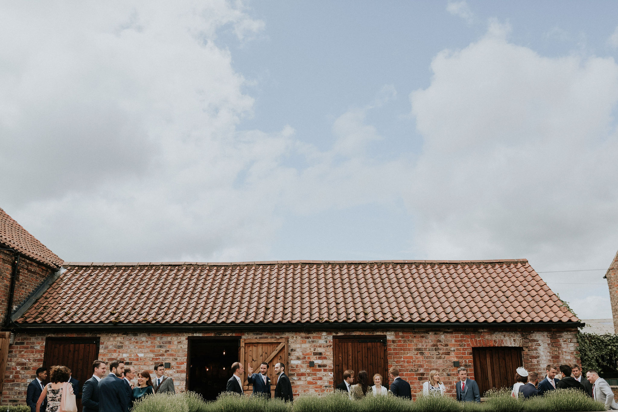 Guests enjoy a pre-ceremony drink in The Normans Courtyard.jpg