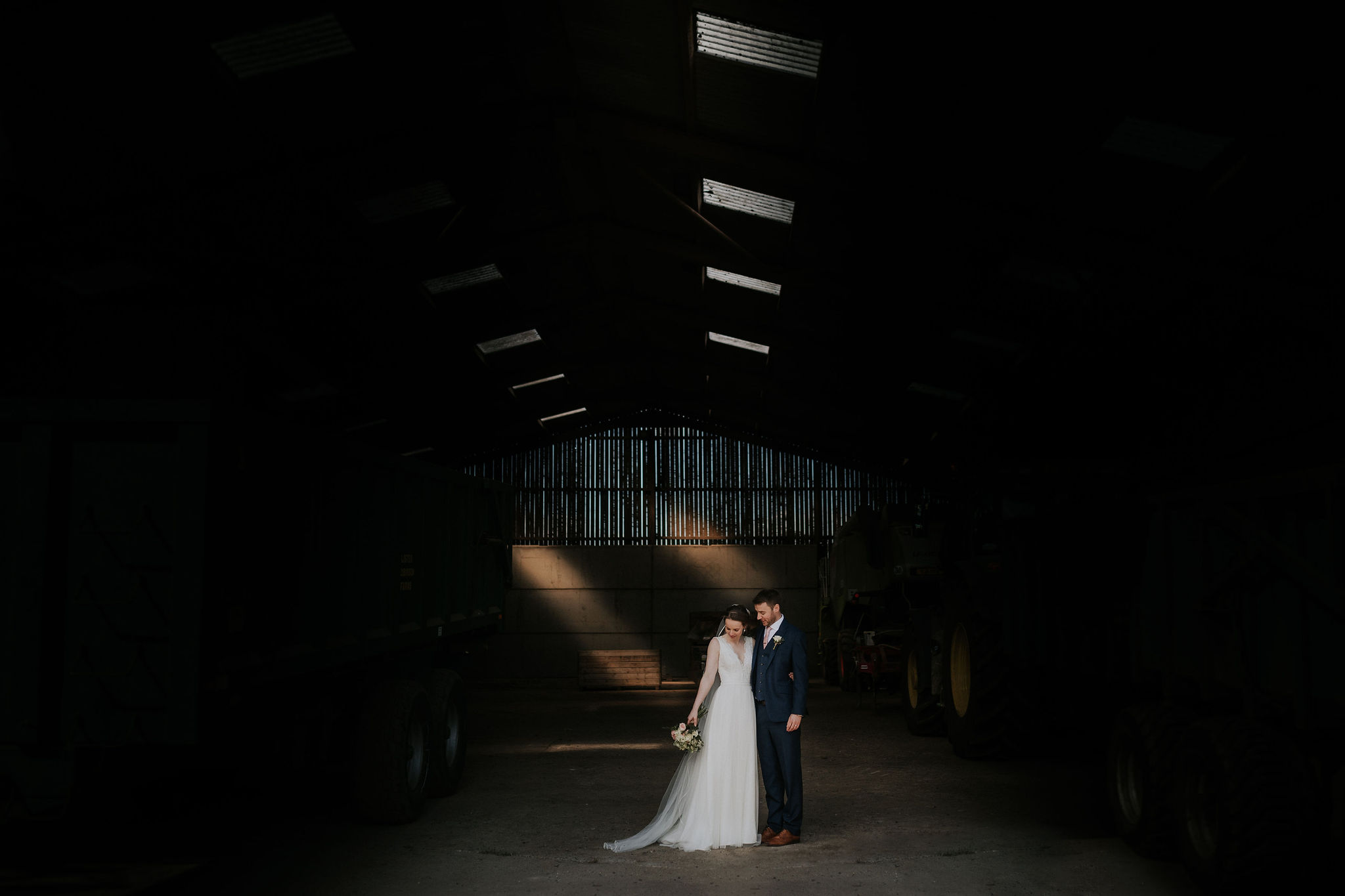 Katie and Rob take cover in a wonderfully lit barn.jpg