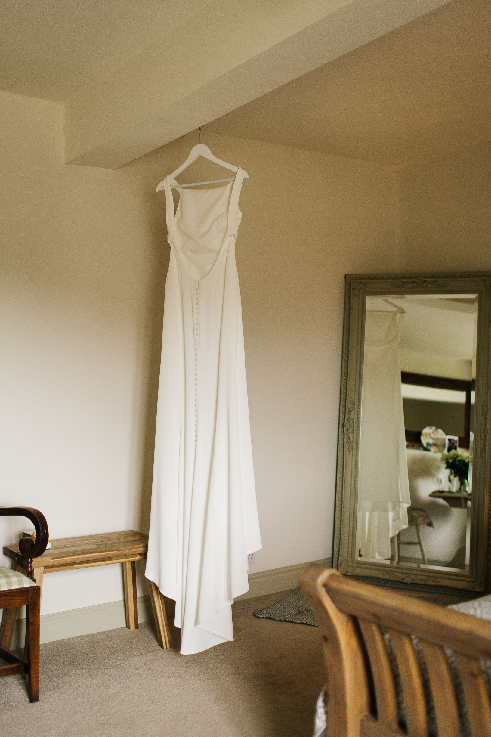 Sarah's stunning dress hanging in The Normans Cottage. Photo by pauljosephphotography.co.uk .jpg