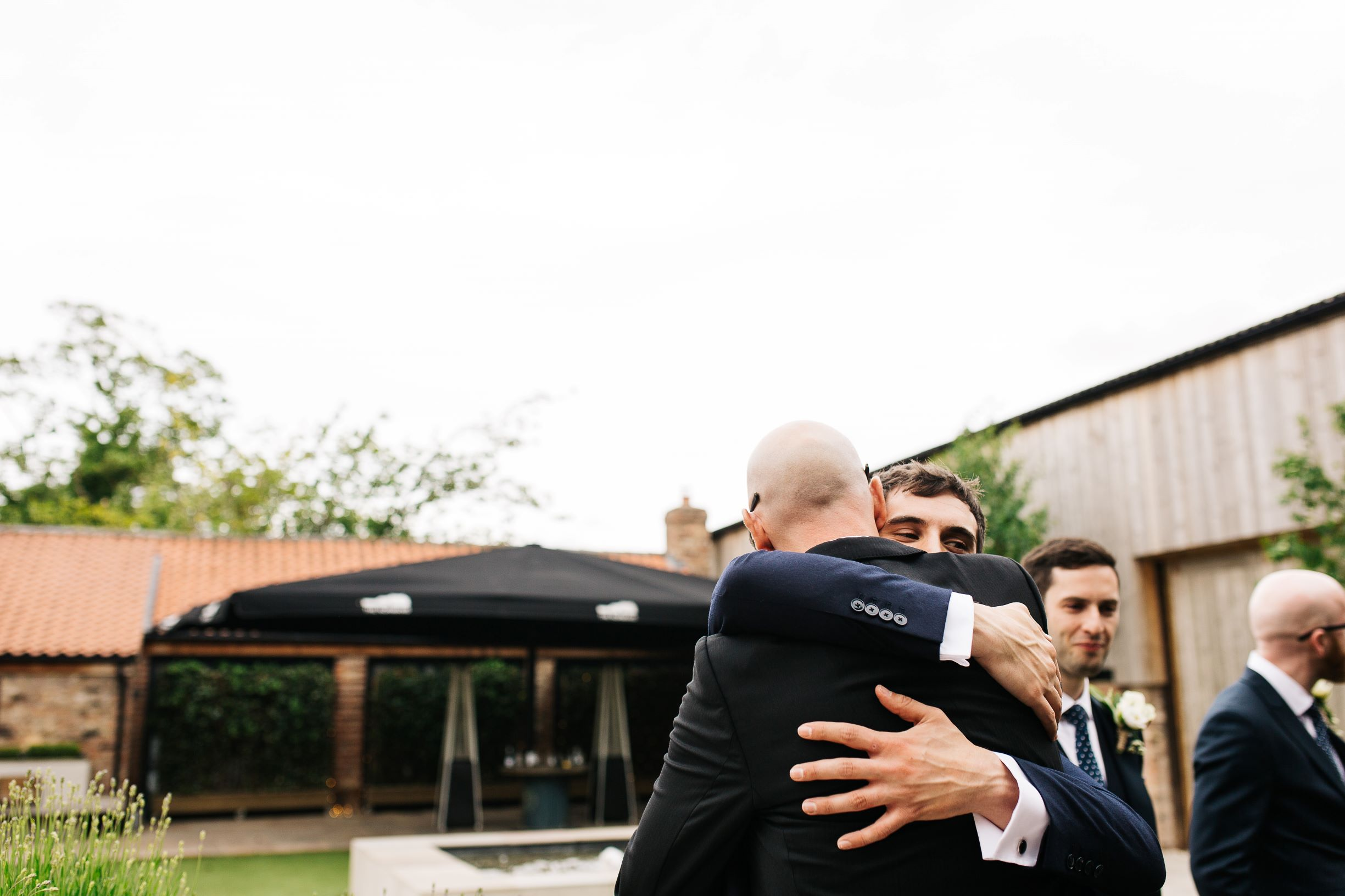 Man hugs in The Normans Courtyard. Photo by pauljosephphotography.co.uk.jpg