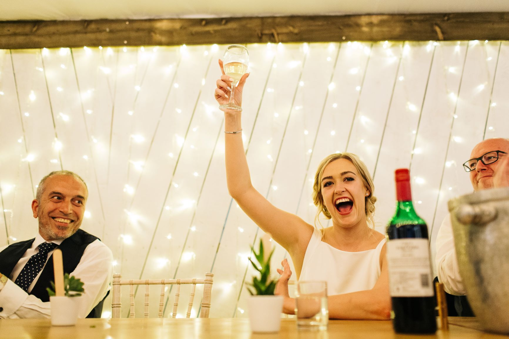 Cheers to that! Bride Sarah raises a glass. Photo by pauljosephphotography.com.jpg
