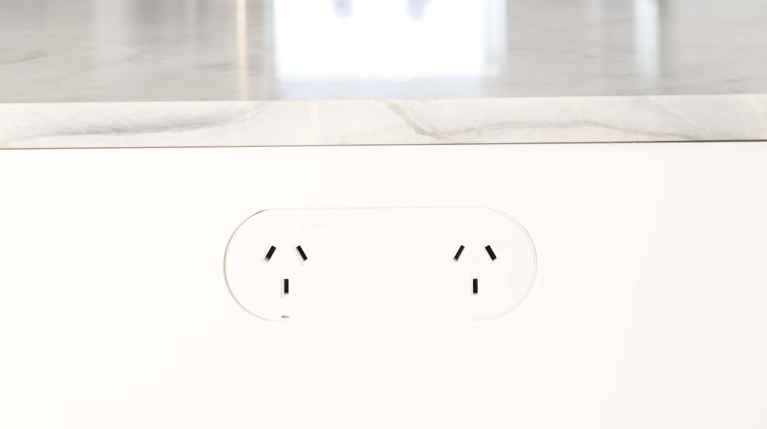 ZETR double outlet in matte white finished flush in kitchen island bench with our adjustable mounting assembly.