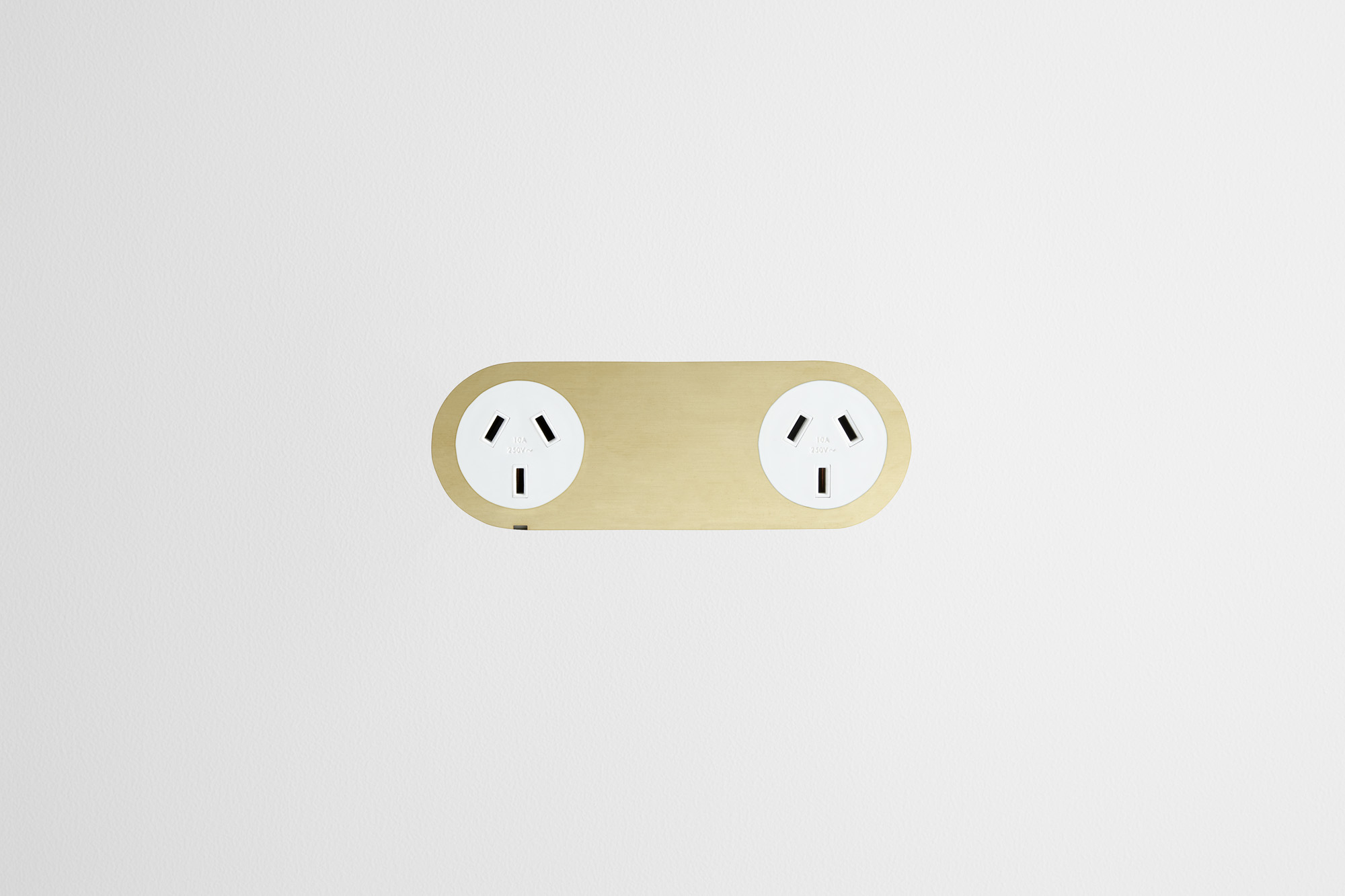 Double_Outlet_Brass_White_Outlet_White_Board.jpg