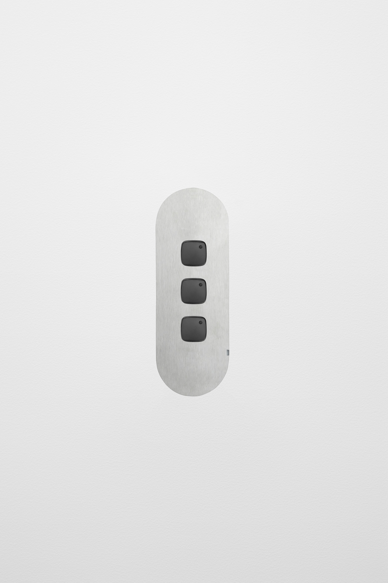 Three_Gang_Switch_Stainless_Steel_Black_Button_White_Board.jpg