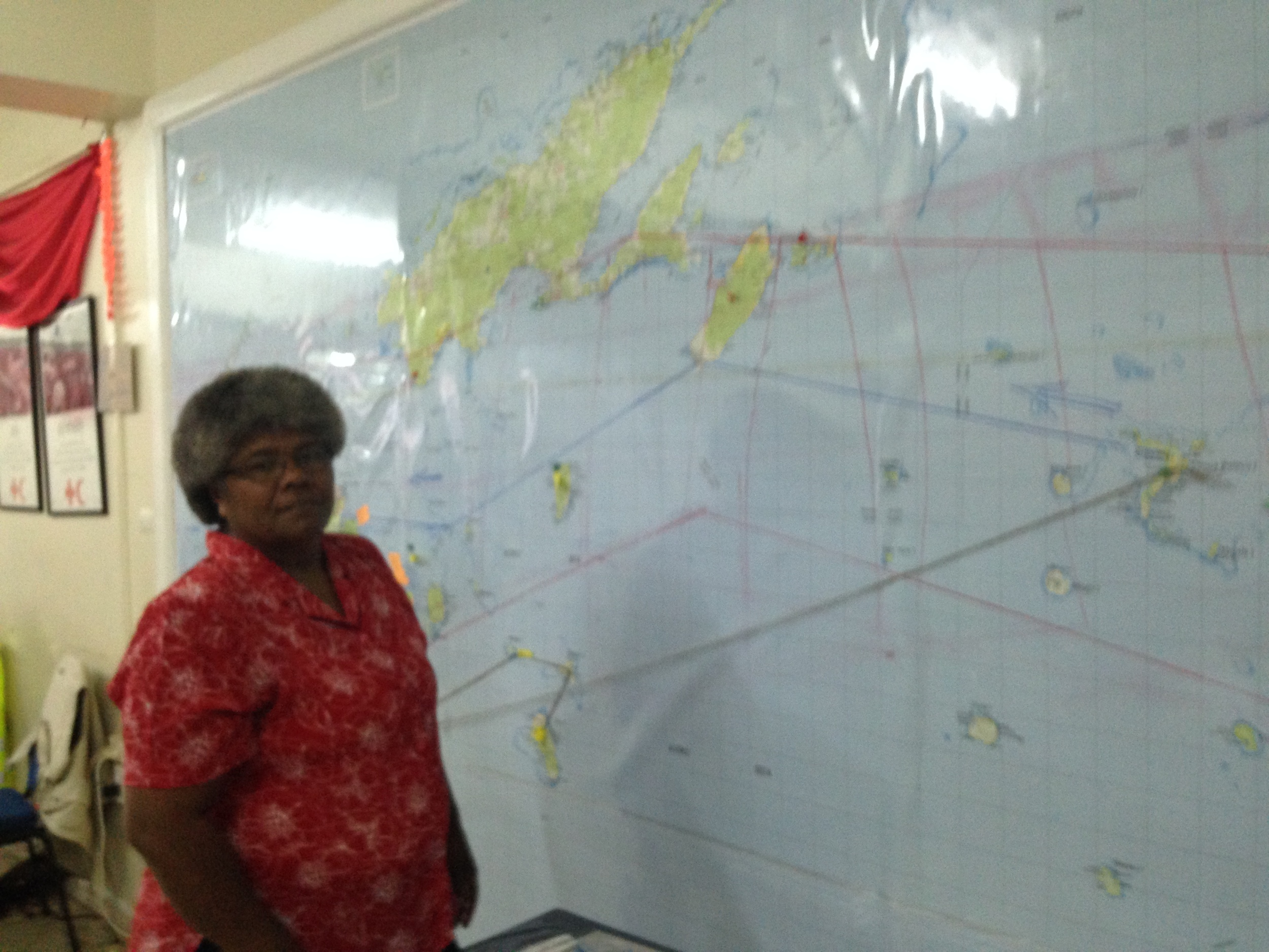Ms Taina Naivalu, Red Cross Fiji,Disaster Projects Officer explains storm damage to Barbara Brezger, Moerk Water
