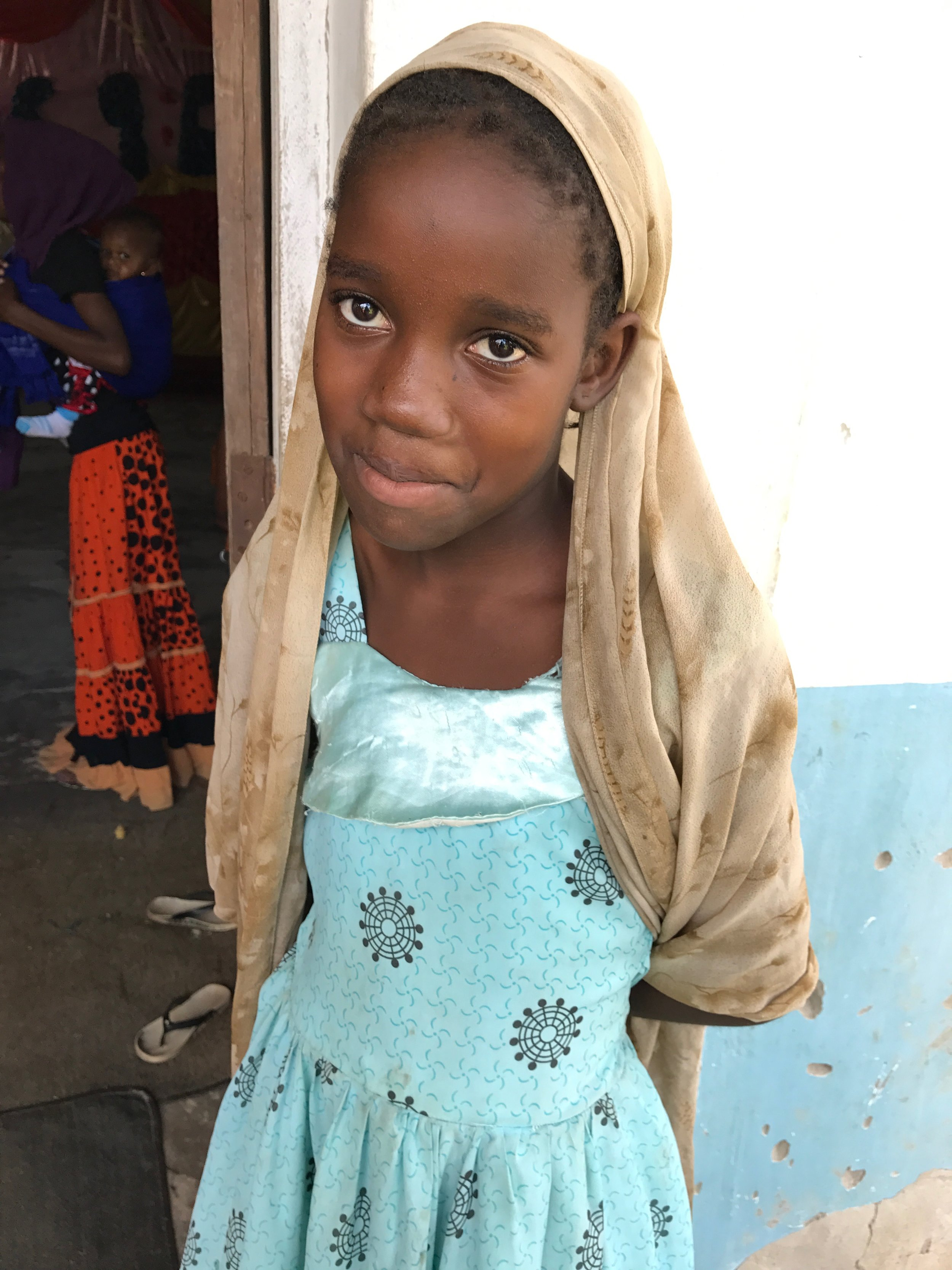 This village girl and her family now enjoy clean water every day