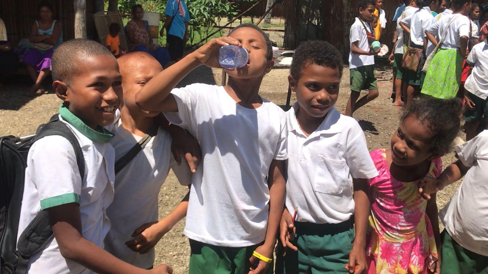 Local school children enjoy drinking from their clean water supply.