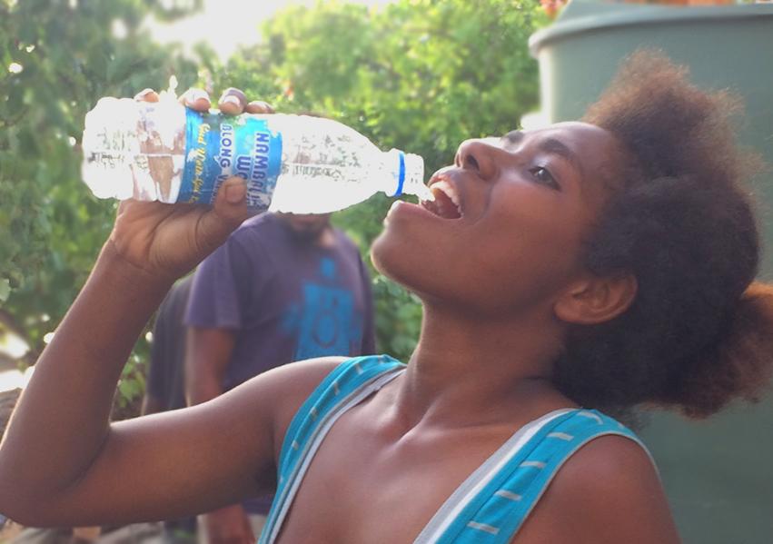 A local girl enjoys fresh water.jpg