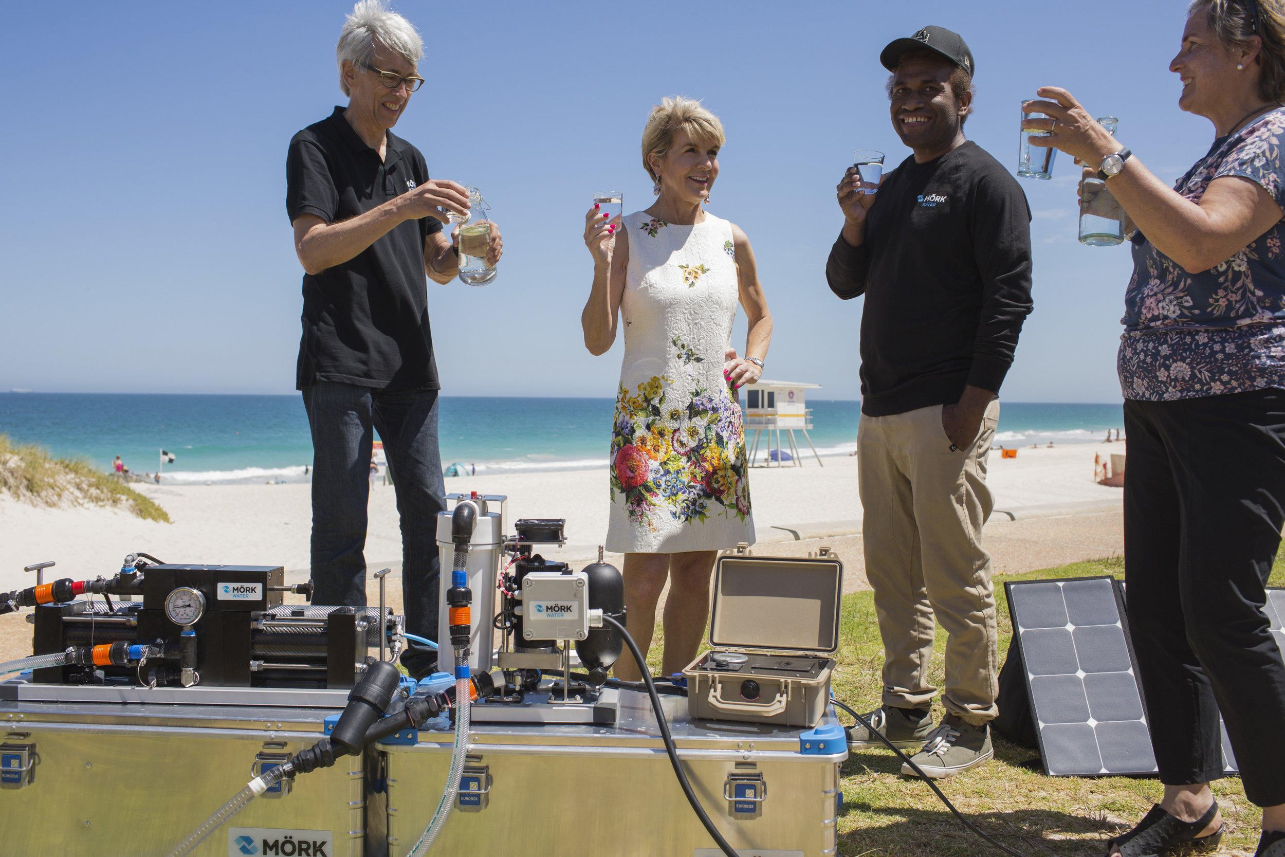 Martin Brezger, the Hon Julie Bishop MP, Robert Iromelafo and Barbara Brezger sample fresh water from the ocean