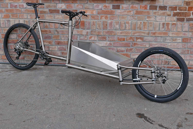 Catan-titanium-Cargobike_lightweight-mixed-surface-gravel-cargo-bike_unique-linkage-arm-steering_engineered-flex_complete-angled.jpg