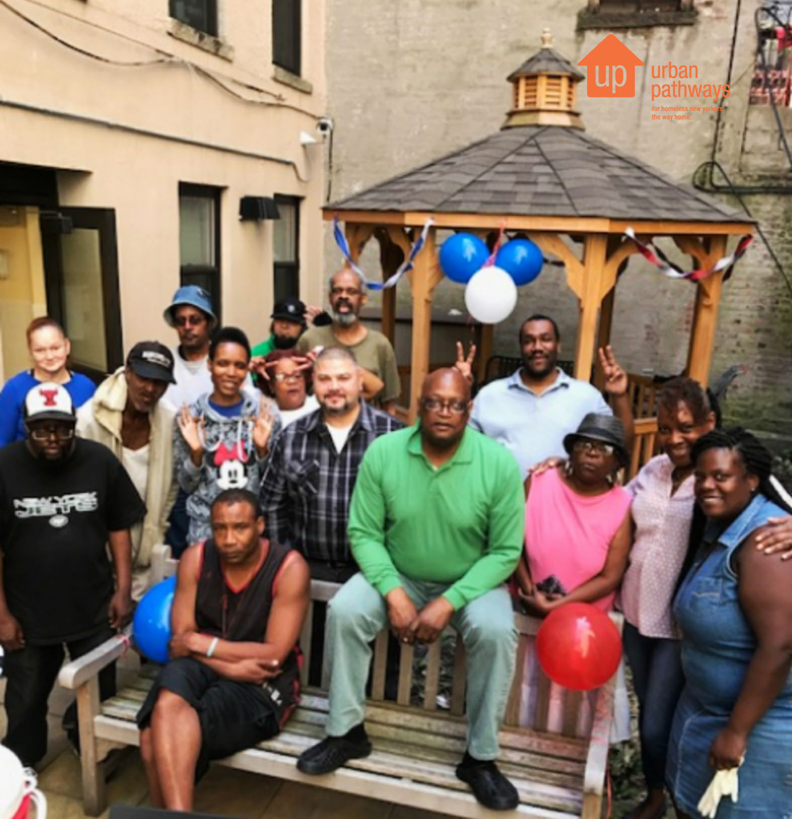 Residents at Cluster House pose for a picture at their holiday barbecue