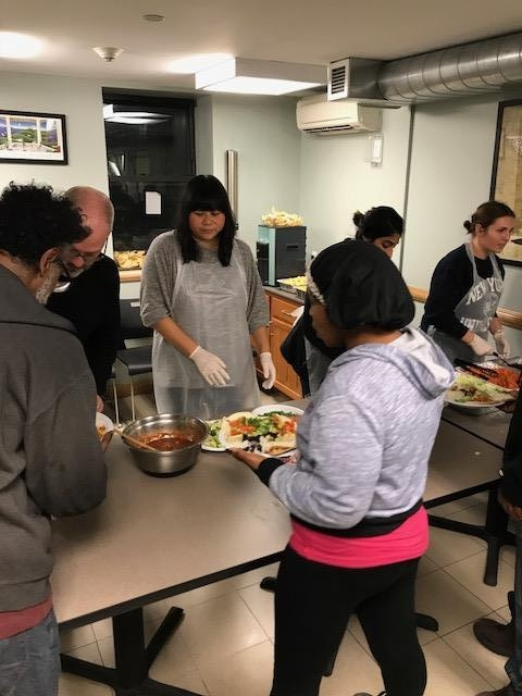 Corporate Volunteer Team from Smart Design cooked and served clients on MLK -Day in Cluster House NYC.