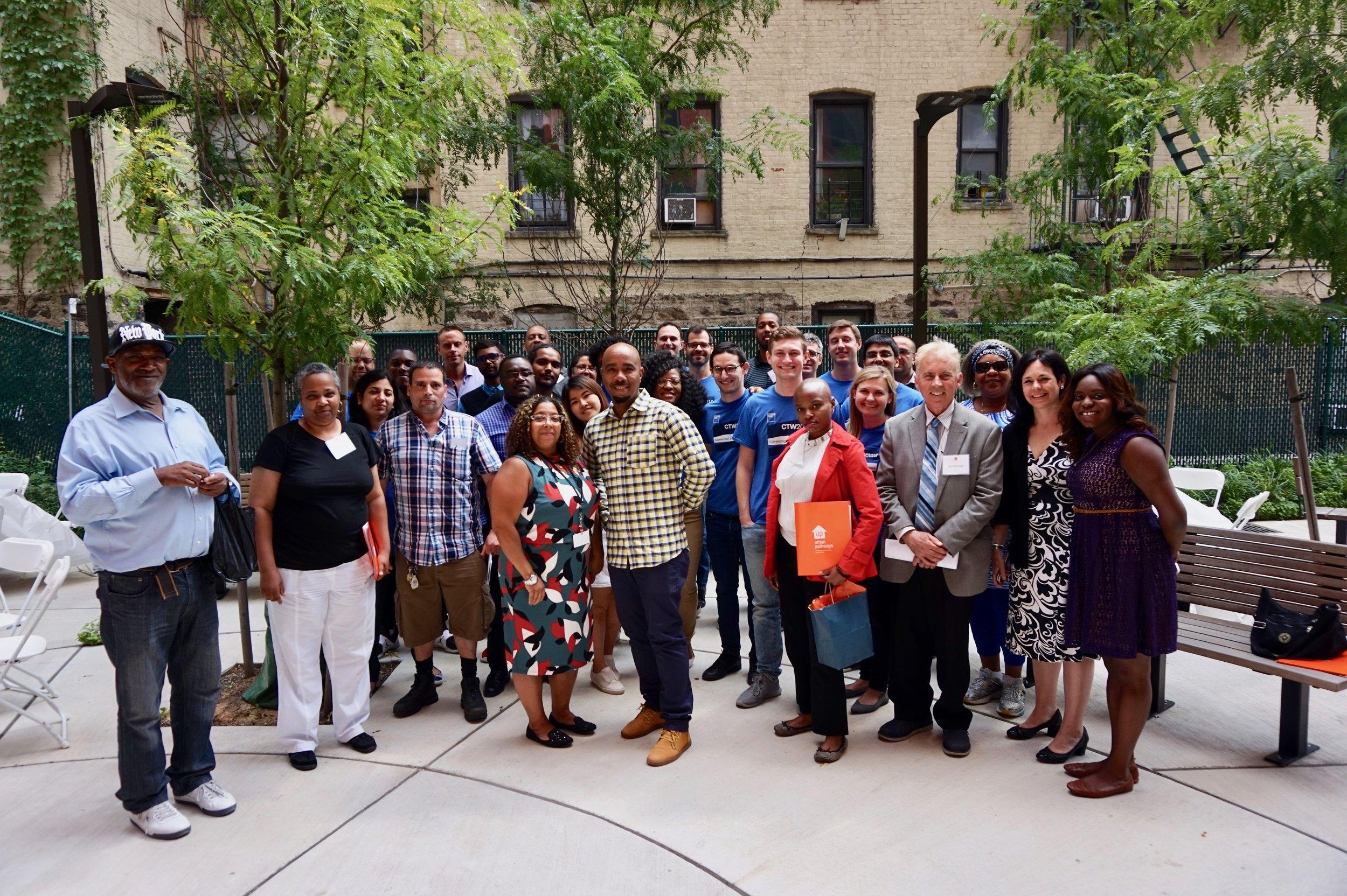 Goldman Sachs Community TeamWorks volunteers, residents, Career Enhancement program participants, Urban Pathways staff, pose during Career Day.