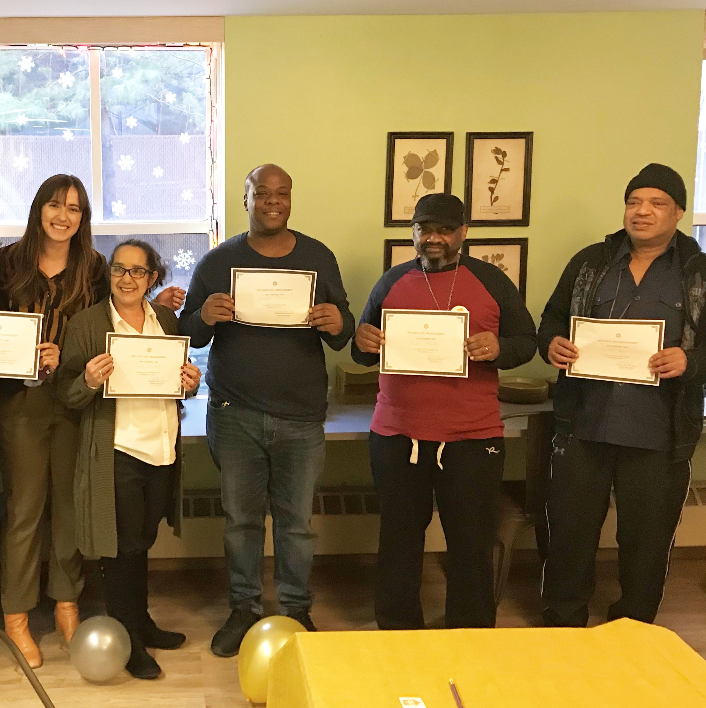 Wellness Self-Management Group Participants receive their certificates of completion.