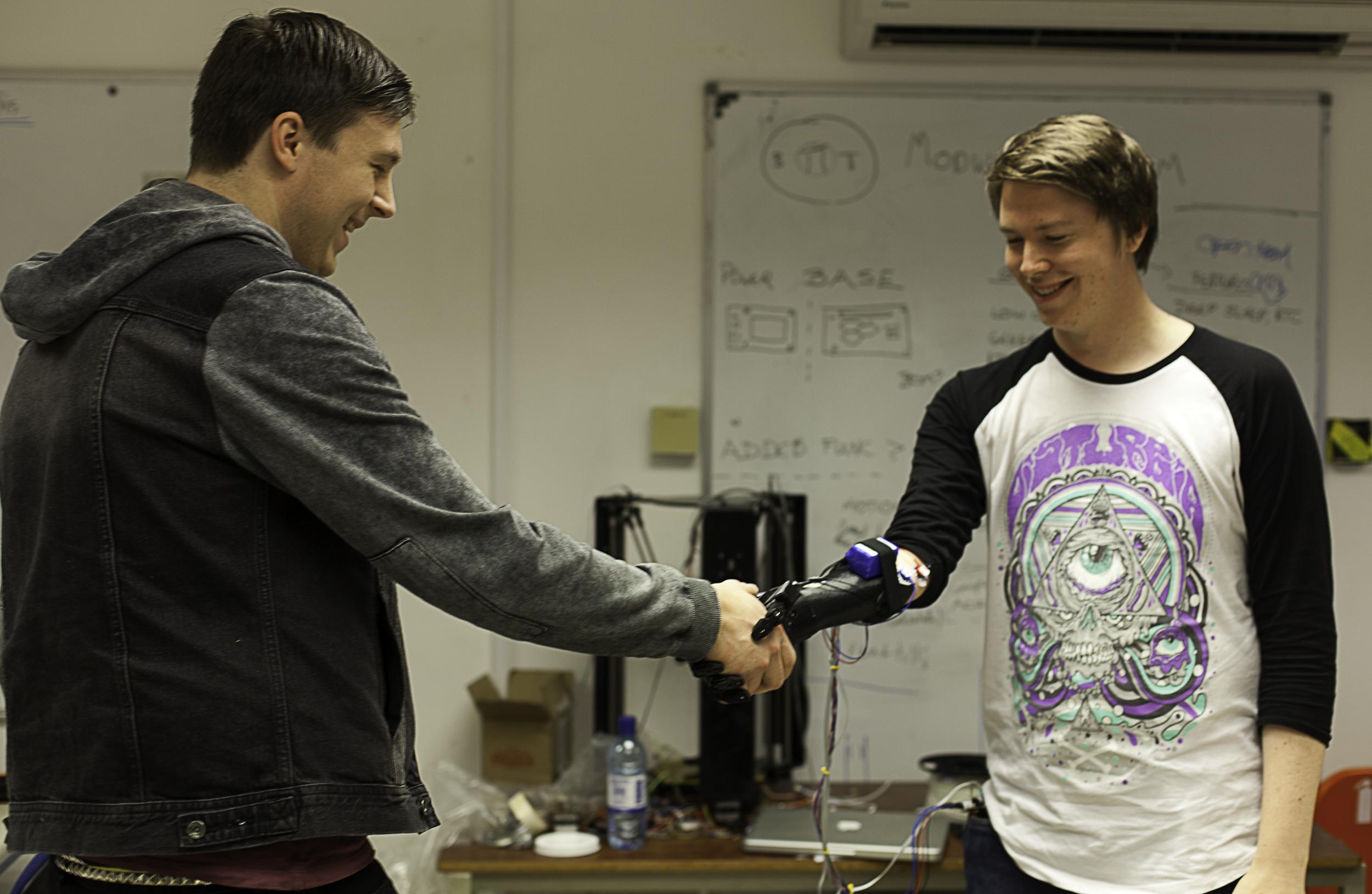 dan melville shaking hands with open bionics robotic hand