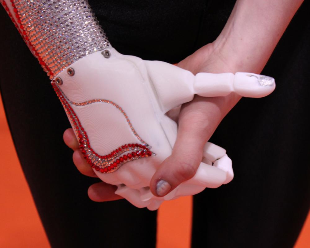 Bionic hand holding human hand