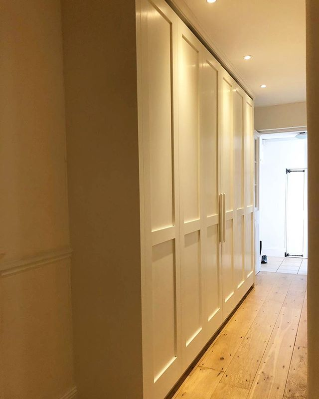 What is your storage design solution for a narrow hallway? Clean lines and modern storage system for the hallway area for our client in Barnes. Hand painted finish with 'Quite White' by @papersandpaints. Swipe left to see how we incorporated the warm white LED motion sensor light by #hafele. See tomorrow's story for the flush sliding door system we used #ps40 . . . . . . #storage #storageideas #interiordesign #itsinthedetails #hallwaydecor #hallwaydecor #hallwaylighting #storagesolutions #london #wellingtonjoinery #papersandpaints #wardrobe