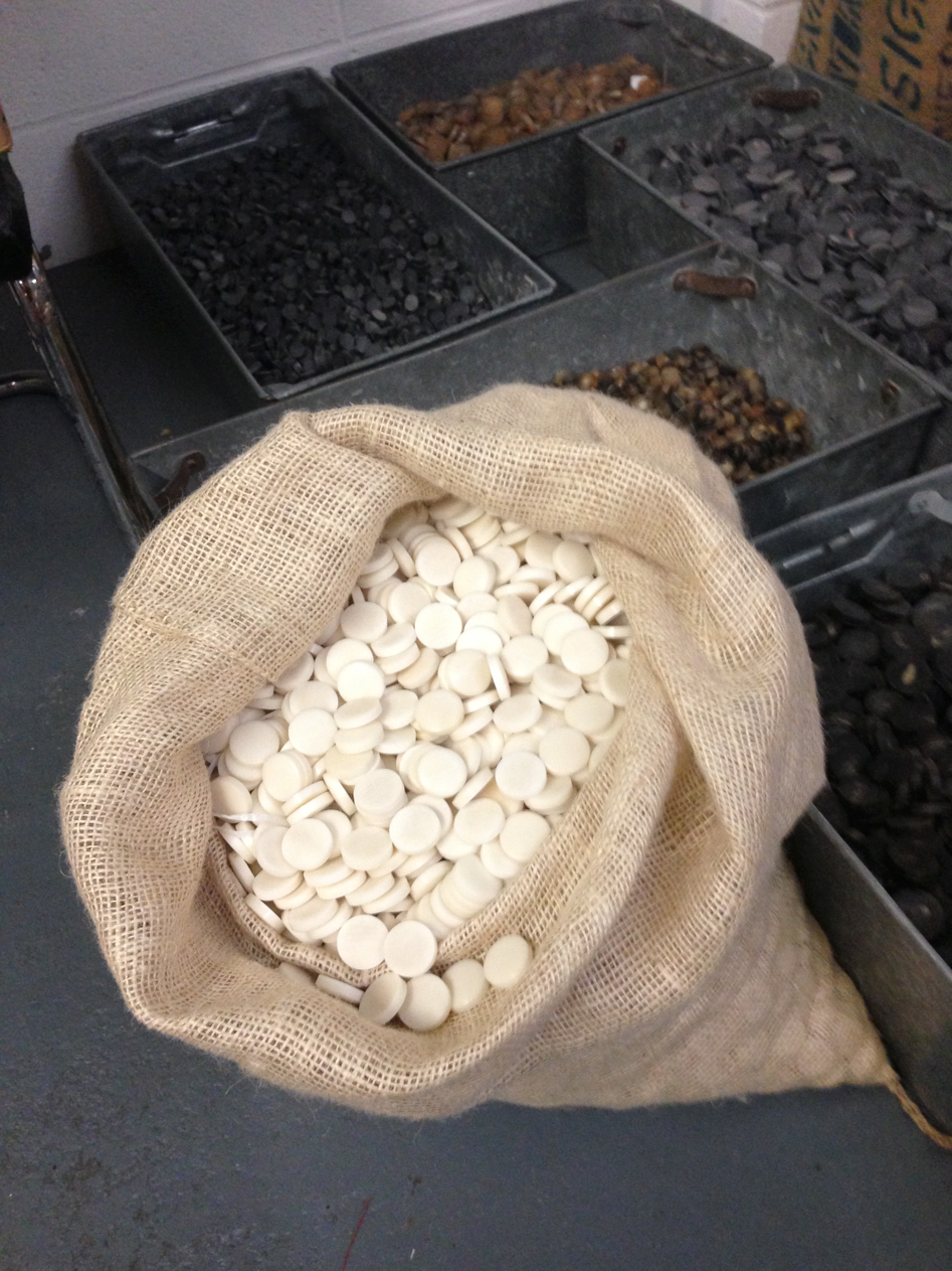 - Button blanks - jute bags containing Corozo (and horn in the background) at the start of the process -the raw material, so to speak.