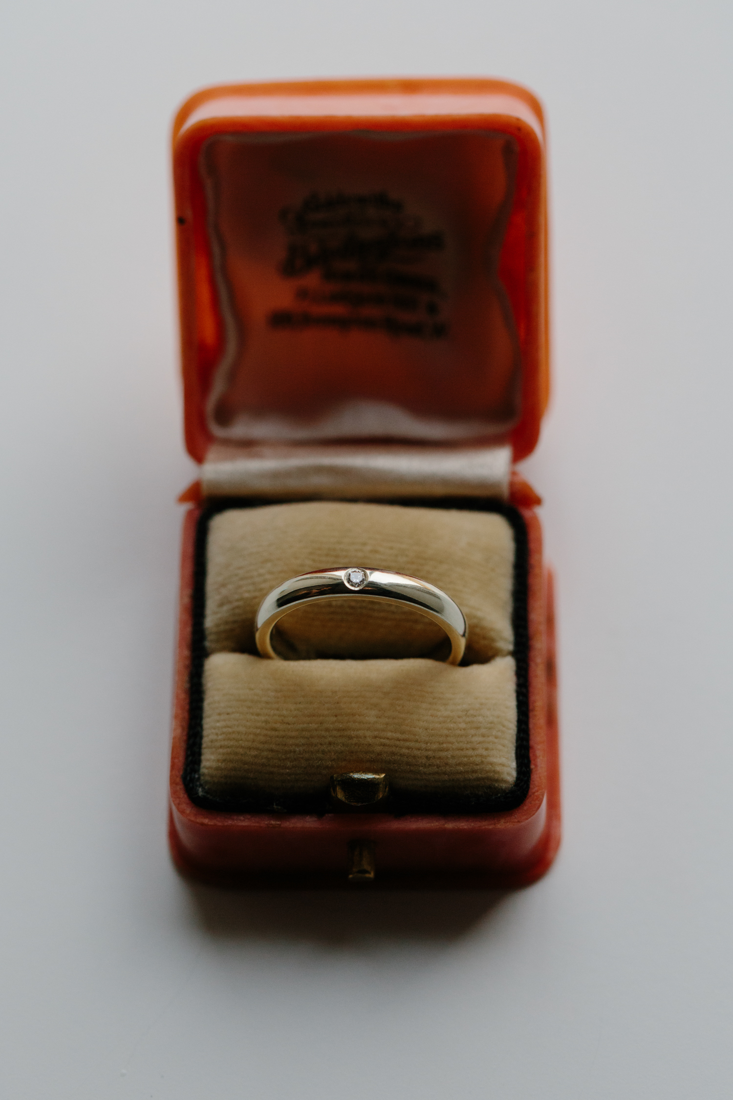 9ct white gold wedding ring, with invisibly set diamond