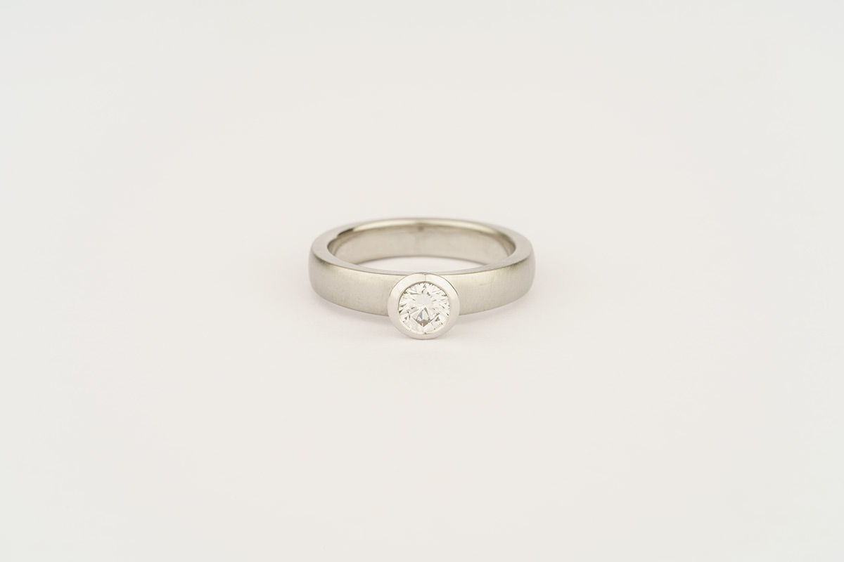 Palladium engagement ring with a rubover setting - set with customer's own diamond