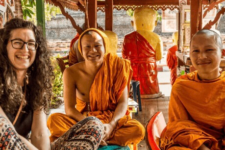 student with monks