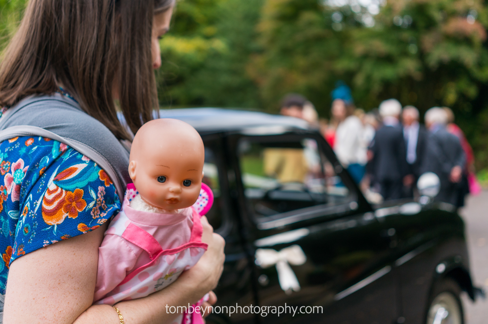 Guest carries doll