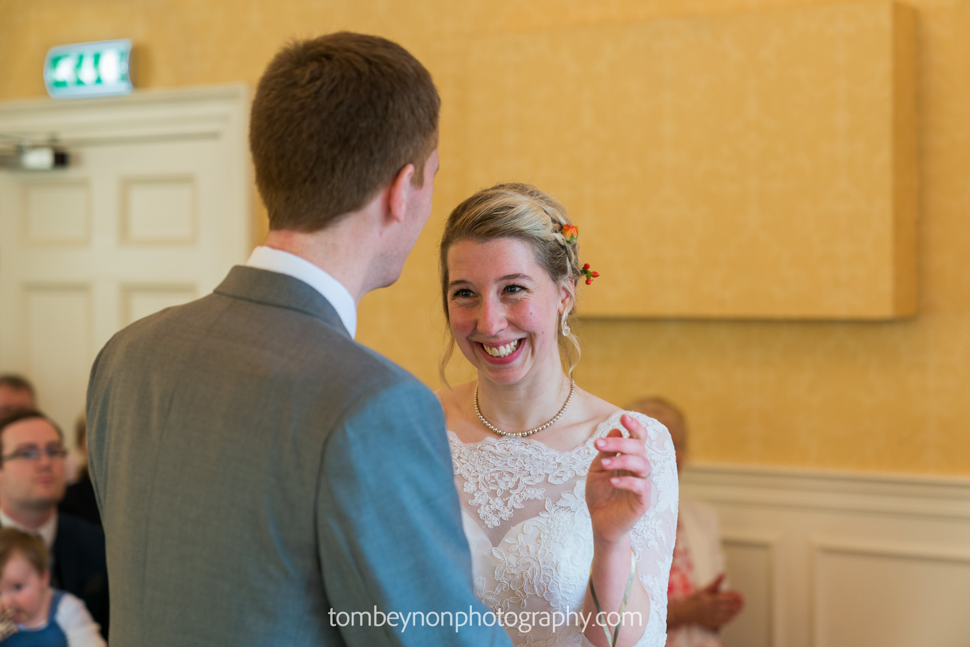 Bride smiles and laughs after vows