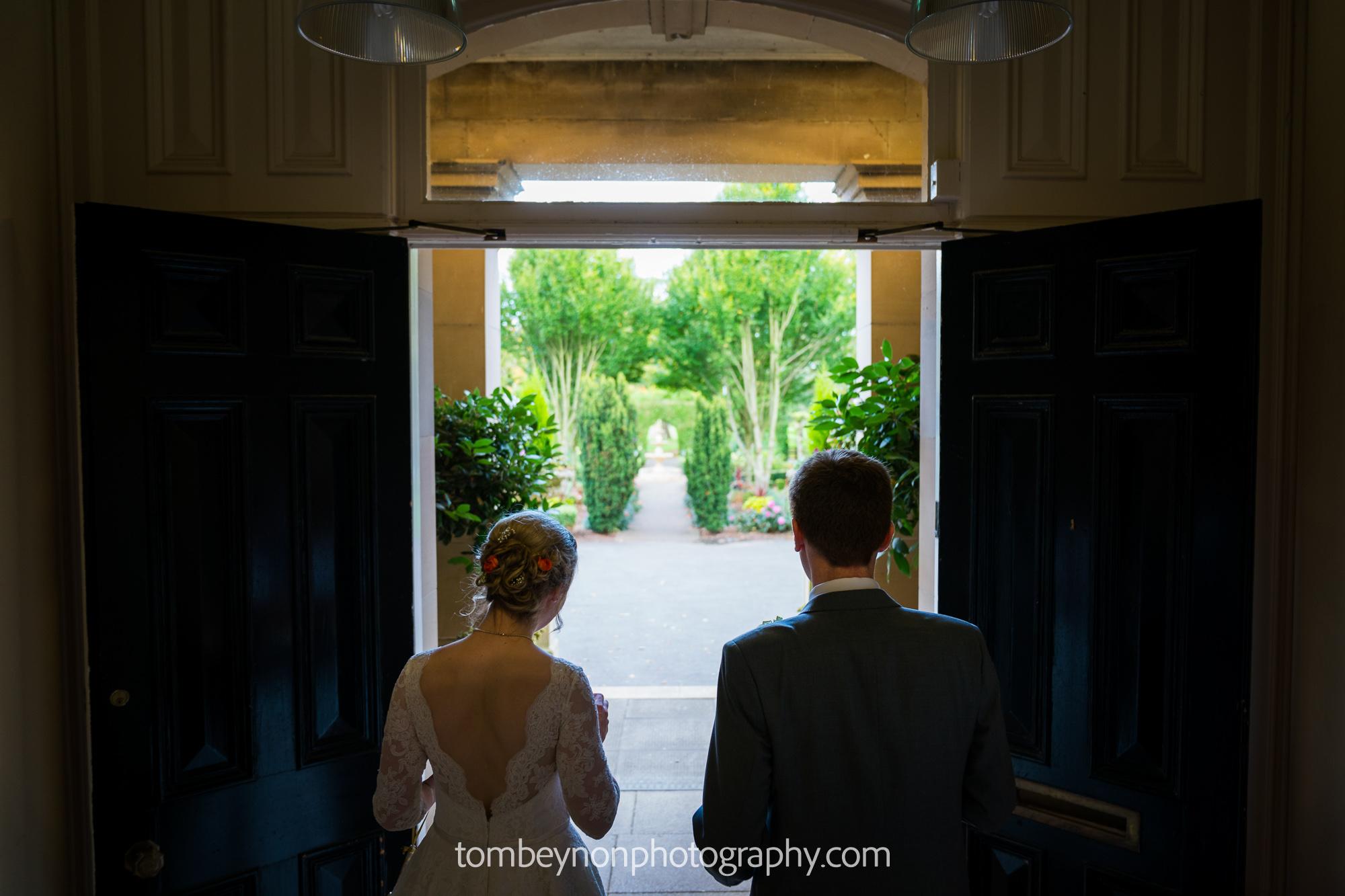 Bride and Groom walk outside together