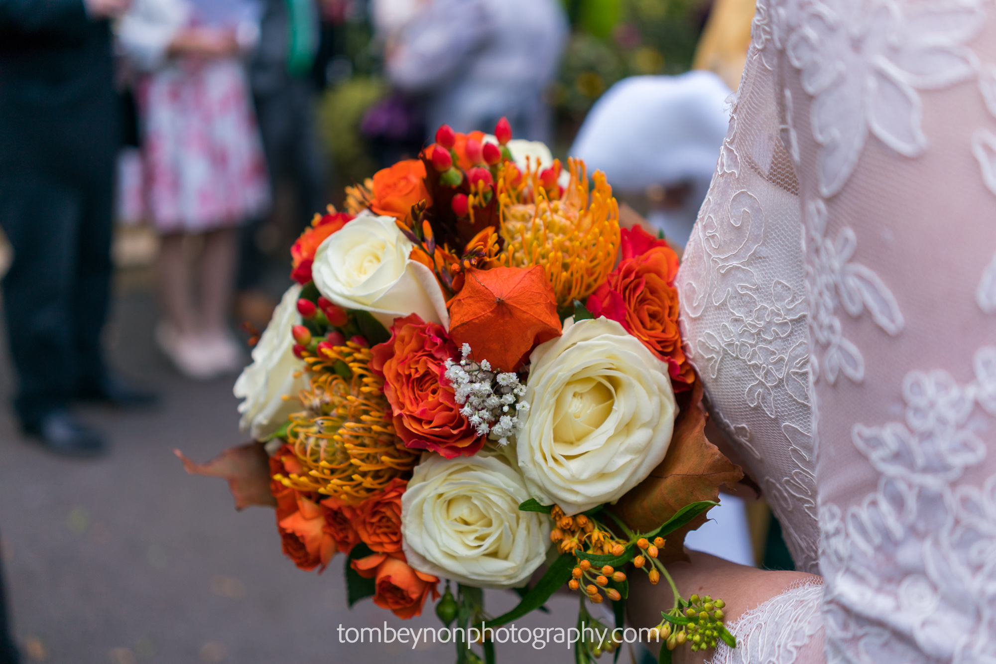 Close up of the bride's flowers and wedding dress detail