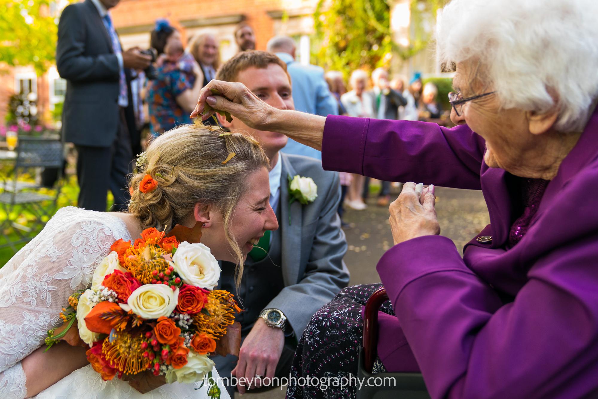 Bride kneels for confetti